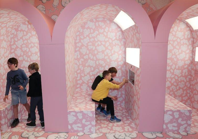 Children in a pink art gallery