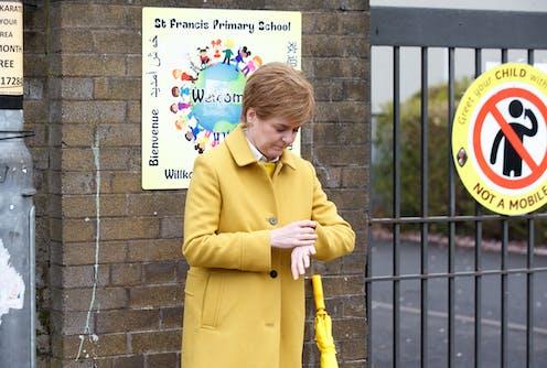 Nicola Sturgeon looking at her watch.