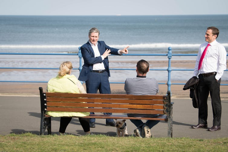Keir Starmer talks to locals on the sea front in Hartlepool.