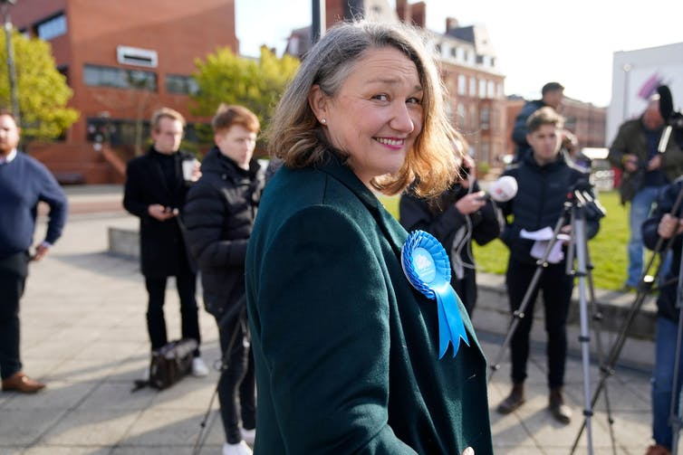 Conservative MP Jill Mortimer in front of a line of press photographers.