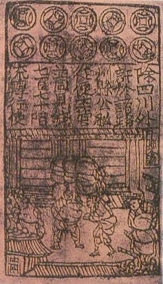 Chinese writing and drawing of several people on pink paper.