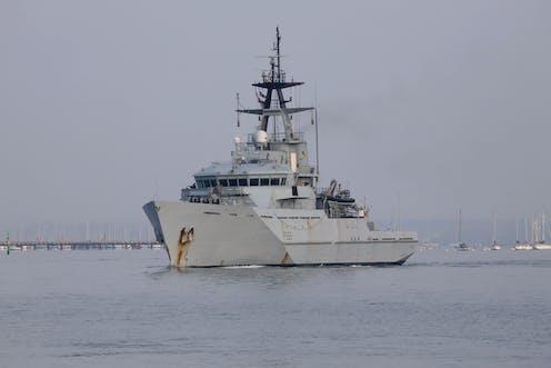 A medium sized grey military ship