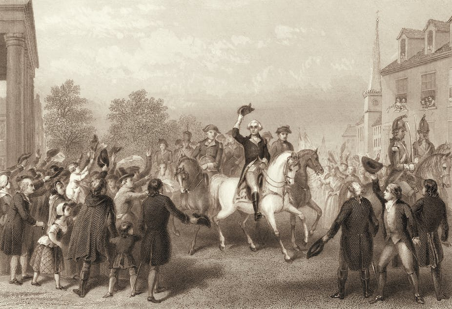 George Washington on horseback doffing his hat in a crowd.