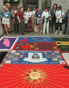 People looking at the AIDS Memorial Quilt