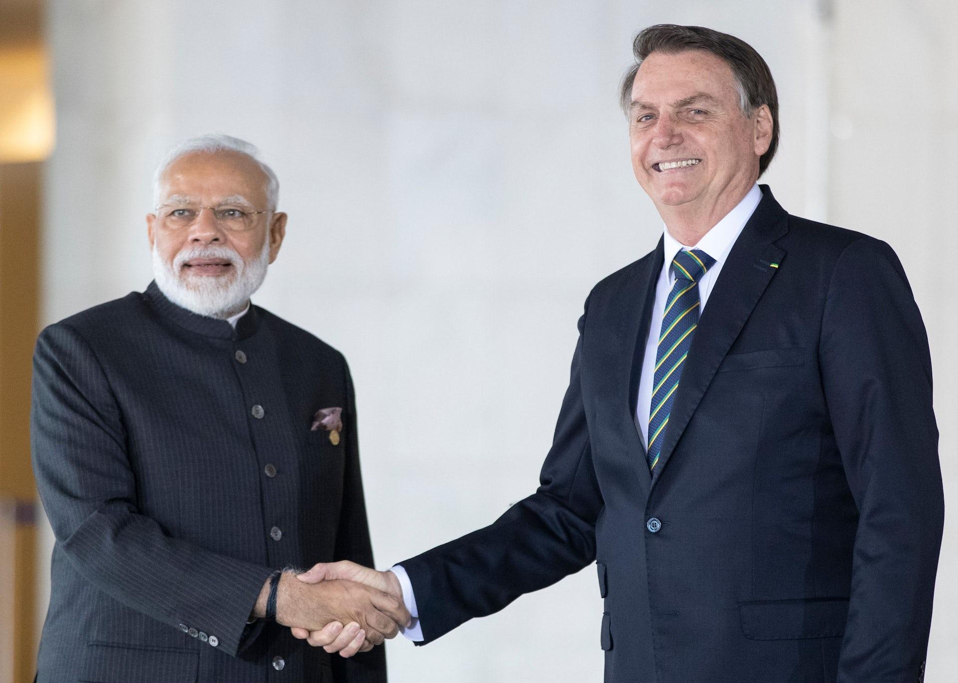 Modi and Bolsonaro shake hands