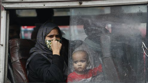 An Indian mother and her infant on a bus in New Delhi.