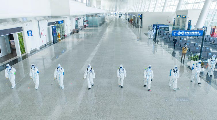Firefighters conduct disinfection at Wuhan Tianhe International Airport in April 2020