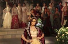 Kangana Ranaut poses at a fashion show.