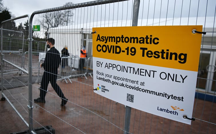Man enters a temporary COVID-19 testing centre