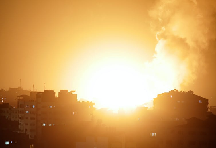 Flames and smoke in the sky over Gaza City following airstrikes launched by the Israeli Defense Force, May 10 2021.