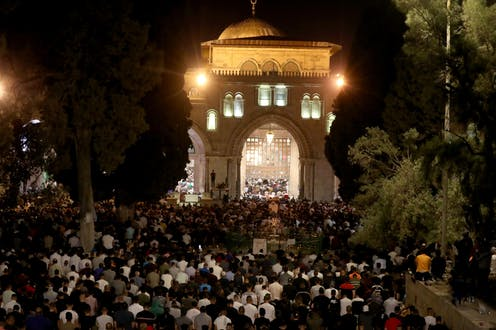 Thousands of Palestinian Muslims praying at al-Aqsa Mosque in Jerusalem, one of Islam's holiest sites, May 8 2021.