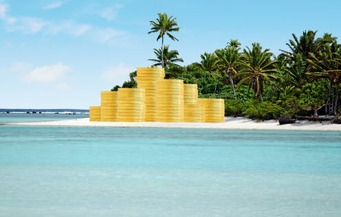 Illustration of piles of giant gold coins on a tropical beach.