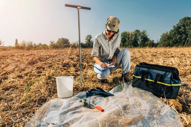 young woman conducting soil testing
