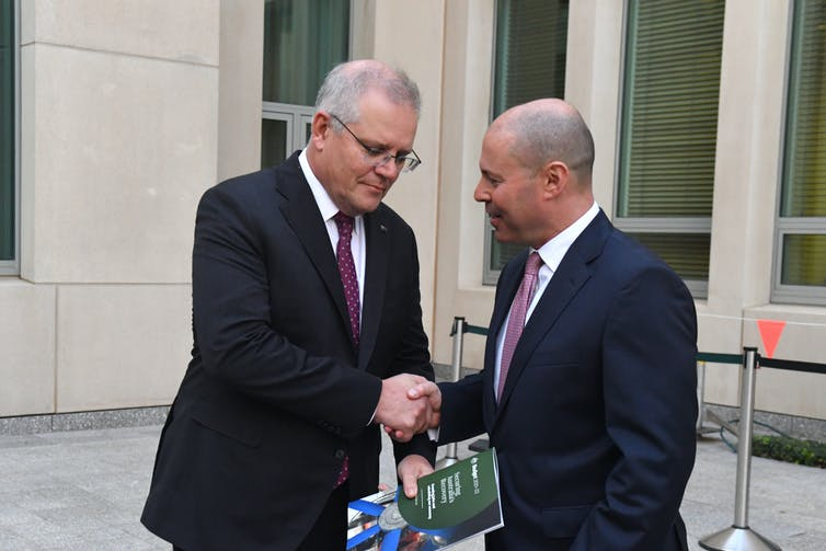 Prime Minister Scott Morrison, left, and Treasurer Josh Frydenberg shake hands