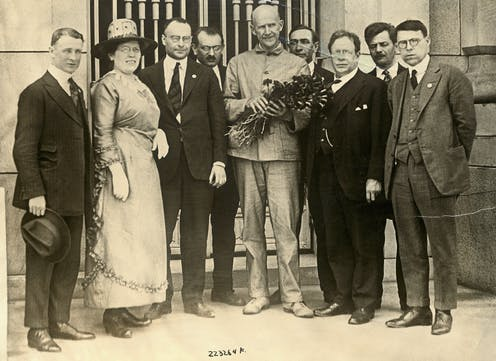 Eight socialist delegates standing with imprisoned Eugene Debs, after notifying him he had been nominated for the presidency on the socialist ticket.