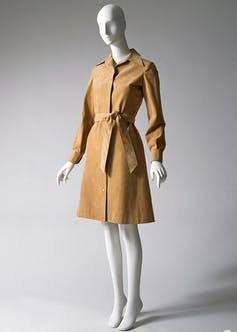 A mannequin dressed in a tan Halston shirtdress.