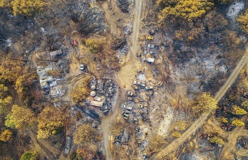 An aerial view of burned structures and cars after the Creek Fire near Shaver Lake, California
