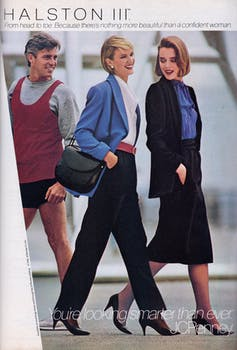 A man looks at two stylishly dressed women walking by.