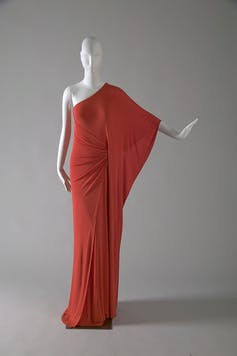 A red dress on a mannequin.