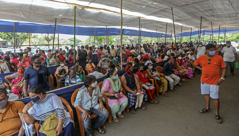 People sitting down waiting for covid vaccine.