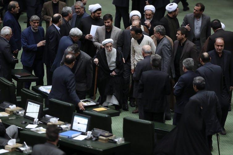 Ayatollah Ahmad Jannati is seen in a crowd of people
