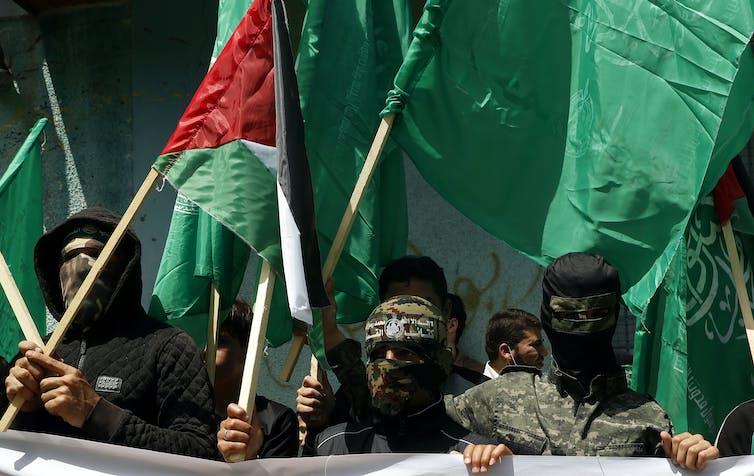 Hamas militants protesting against Abbas.