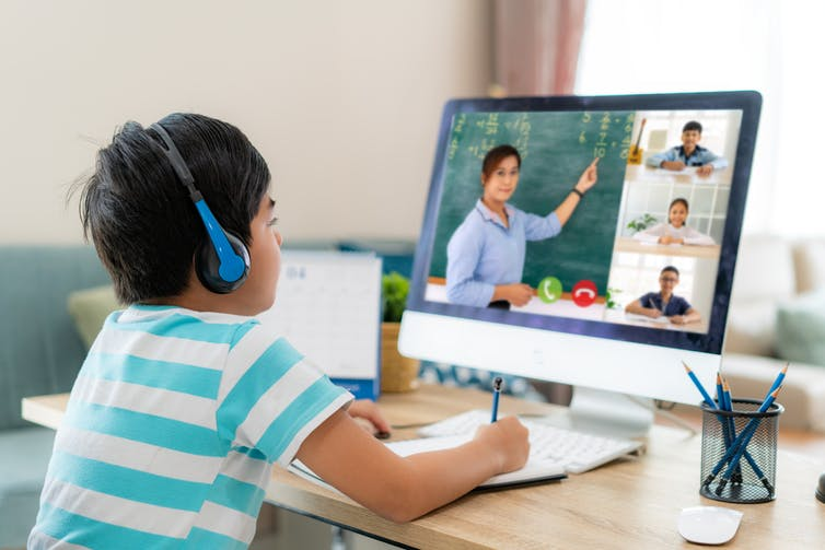 Boy learning from teaching on Zoom screen.