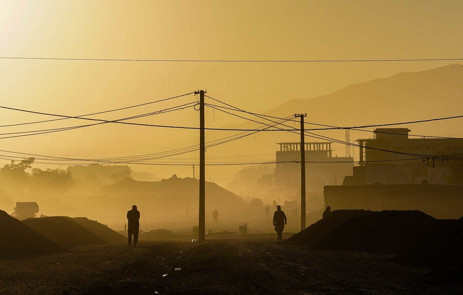 Two men in silhouette in the early morning in Kabul