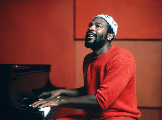 Marvin Gaye sitting at the piano.