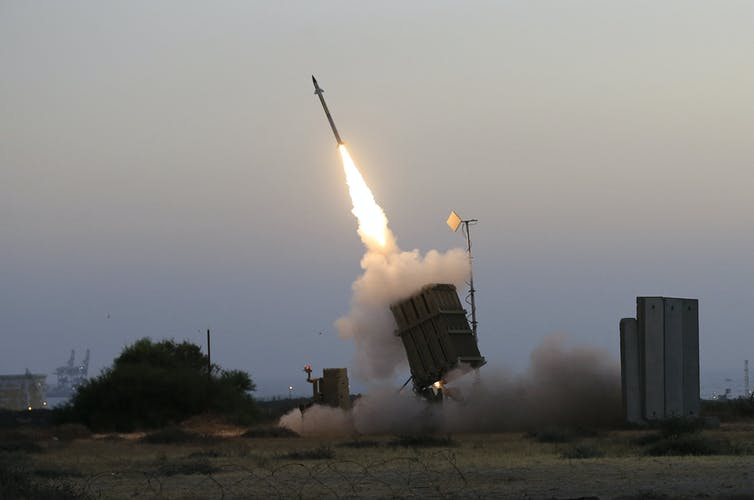 An Iron Dome air defence system fires to intercept a rocket