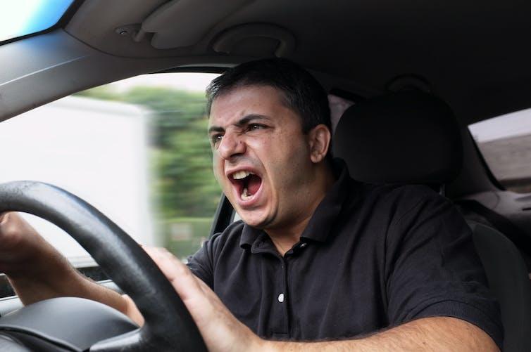 Angry man yells while driving