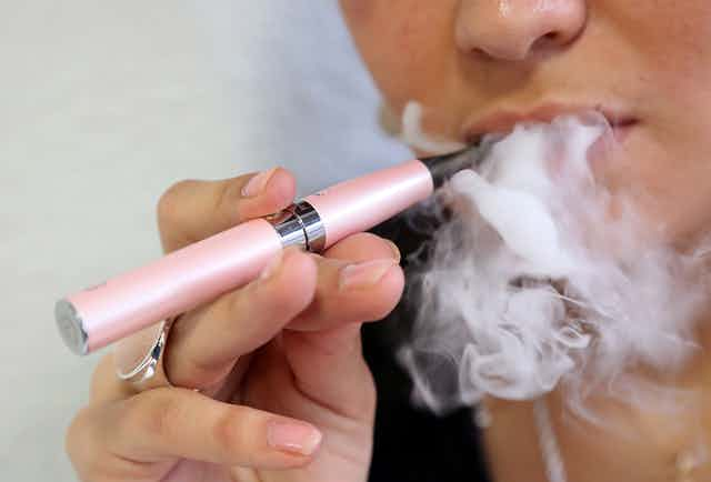 Close-up of someone smoking e-cigarette
