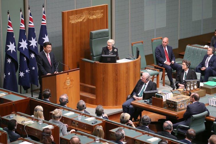 Chinese. man speaks to Australian parliament