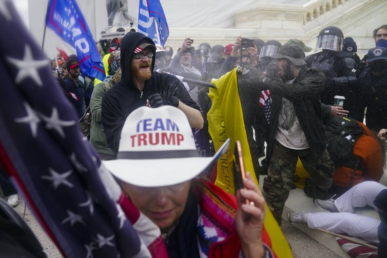 Trump supporters, believing false claims a election was stolen, try to break through a police barrier at the US Capitol in on January 6 2021.