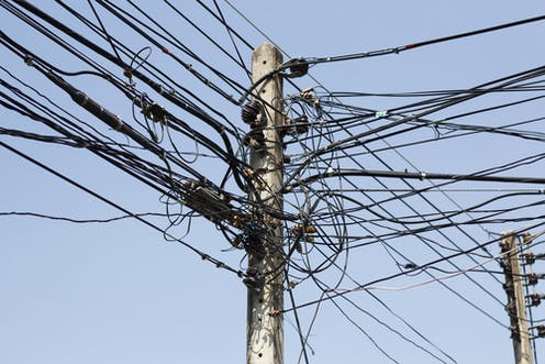 An electricity post with many wires connected to is as a result of illegal electricity connections.
