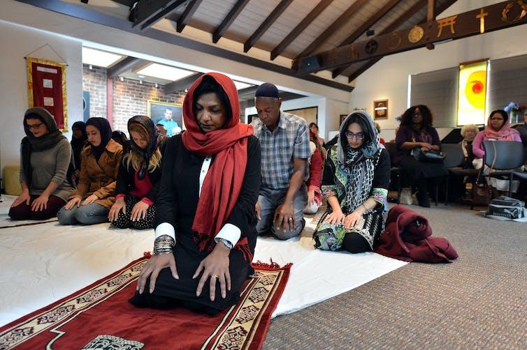 A Muslim woman leads prayers inside the Qal'bu Maryam women's mosque in Berkeley, California.
