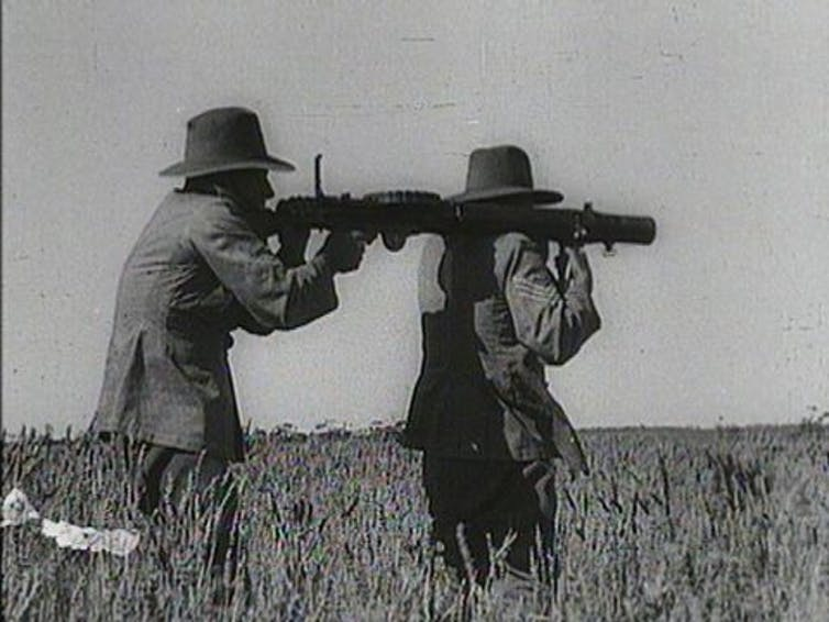 Two soldiers from 1930s with guns