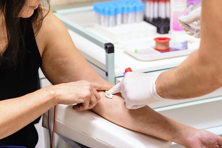 Woman has blood taken for a blood test.