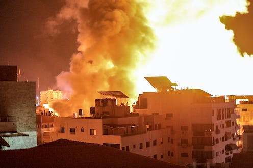 Flames and smoke over the Gaza City skyline during an airstrike by Israeli aircraft.