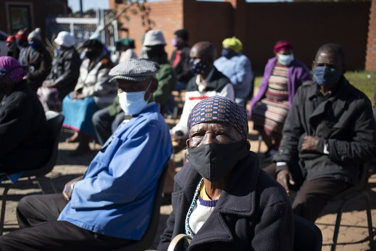 Members of the community wait in line to receive their vaccination in Johannesburg.
