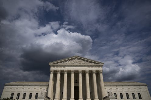 Photo of the Supreme Court building with ominous clouds overhead