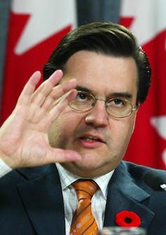 Coderre gestures while speaking.