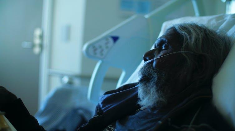 Gulpilil in a hospital bed