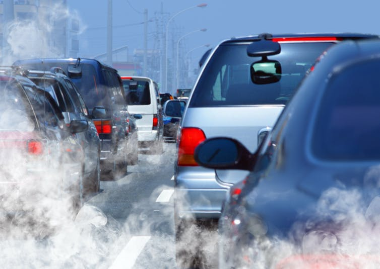 stuck in traffic with exhaust fumes