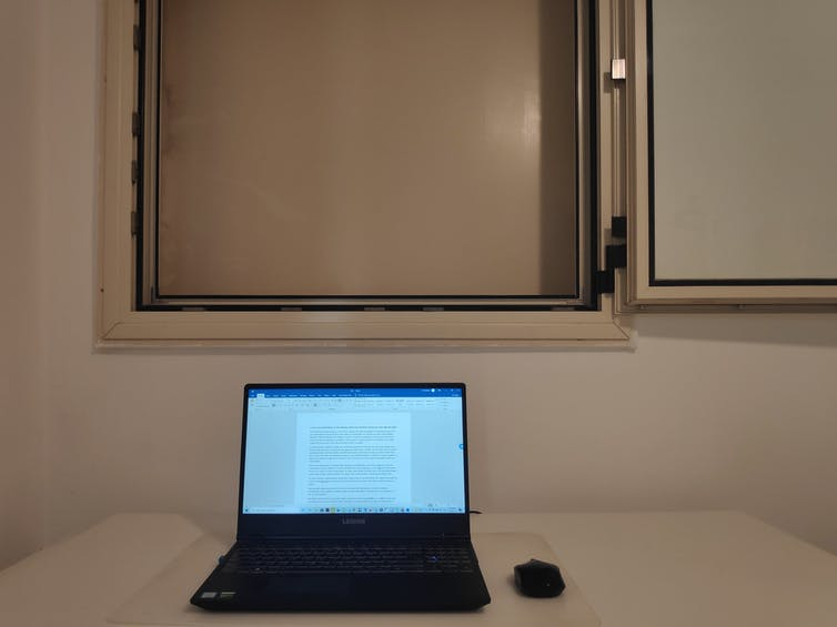 A laptop computer on a desk