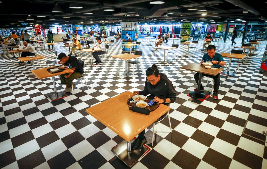 Socially distanced diners eat a food-court in Bangkok.