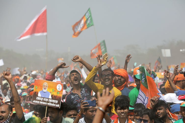 A crowded outdoor political rally in India in March 2021