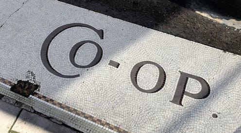 A floor mosaic reads 'co-op'