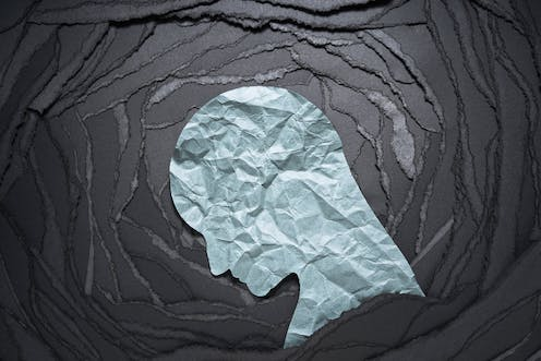 A human head shape made from paper.