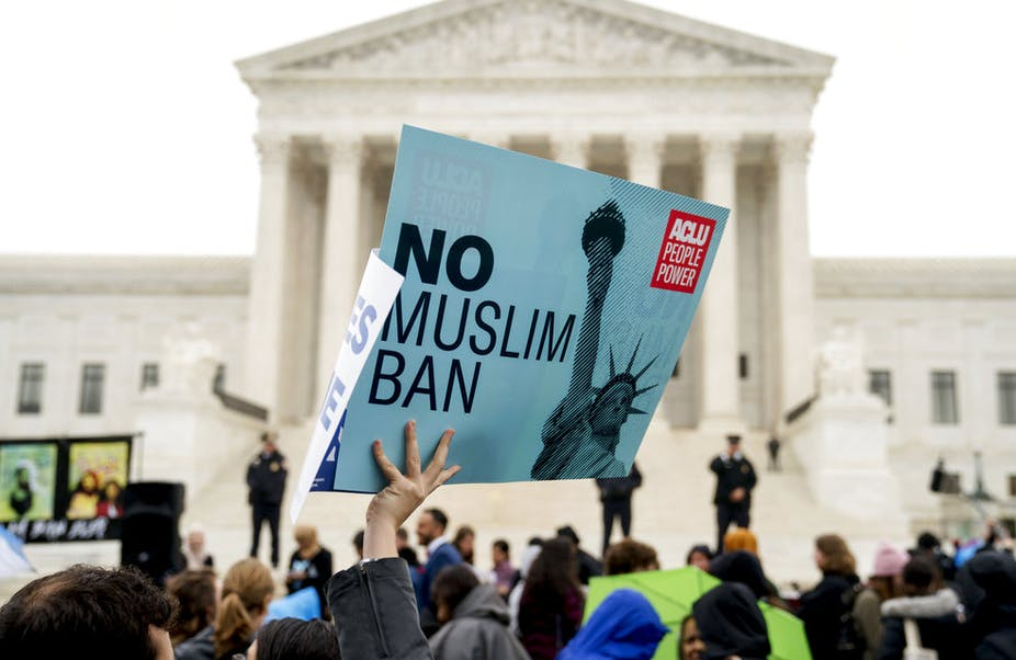 """A person holds up a sign that reads """"No Muslim Ban"""" during an anti-Muslim ban rally at the Supreme Court , Wednesday, April 25, 2018,"""